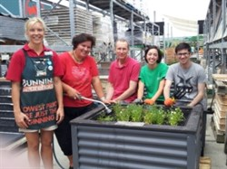 Penny, Ann, John, Sara and Tony at Bunnings Tower Junction filling planter boxes.