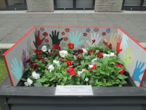 2014 Festival of Flowers planter box with artwork by students at The Migrants Centre.