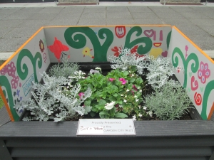 2014 Festival of Flowers planter box with artwork by kids from Te Puna Oraka's holiday programme.